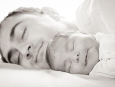 baby and daddy sleeping