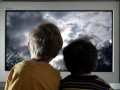 LONDON - JANUARY 27:  In this photo illustration two young child watch television at home, January 27, 2005 in London, England.   (Photo Illustration by Peter Macdiarmid/Getty Images)