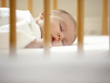 Baby sleeping in crib