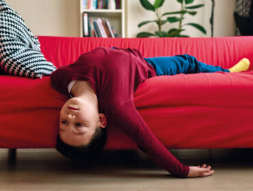 Bored child on living room.